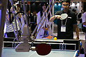 An exhibitor plays table tennis with Omron's FORPHEUS robot during a media event at CEATEC Japan 2016 on October 3, 2016, Tokyo, Japan. The robot was earlier certificated by Guinness World Records as the first robot table tennis tutor. CEATEC Japan is a cutting-edge IT and electronics exhibition. This year there are 648 companies and organisations taking part from 24 different countries and the show is open to the public from October 4 to 7. (Photo by Rodrigo Reyes Marin/AFLO)