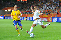 Alex Morgan (r) of team USA and Annica Svensson of team Sweden during the FIFA Women's World Cup at the FIFA Stadium in Wolfsburg, Germany on July 6thd, 2011.