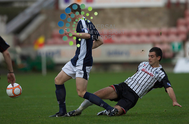 Scottish Irn-Bru First Division Championship Season 2009/10.Dunfermline Football Club  v  Dundee Football Club..  .  Dundee's Craig Forsyth is tacled by Dunfermline's Steven Bell during todays thrilling encounter between Dunfermline and Dundee at East End Park, Dunfermline...Picture, Mark Davison/Universal News and Sport.
