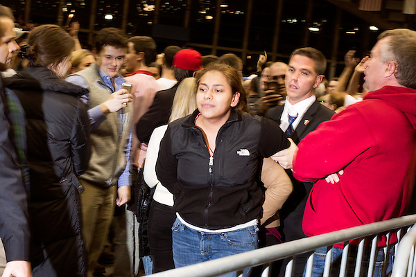 December 4, 2015. Raleigh, NC.<br />  A protestor is escorted out of the rally.<br />  Republican Presidential candidate Donald Trump spoke to a crowd of thousands at Dorton Arena on the NC State Fairgrounds Friday night. Touting his tough stance upon immigration, Trump also touched on the war in Syria and the American educational system.