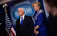 United States Vice President Mike Pence and Dr. Deborah L. Birx, White House Coronavirus Response Coordinator and Deborah Birx, Coronavirus response coordinator for the White House Coronavirus Task Force, listen to US President Donald J. Trump deliver remarks on the COVID-19 (Coronavirus) pandemic during a Coronavirus Task Force briefing in the Brady Press Briefing Room at the White House in Washington, DC, March 18, 2020, in Washington, D.C. <br /> Credit: Kevin Dietsch / Pool via CNP/AdMedia