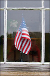 The American flag seen through a window