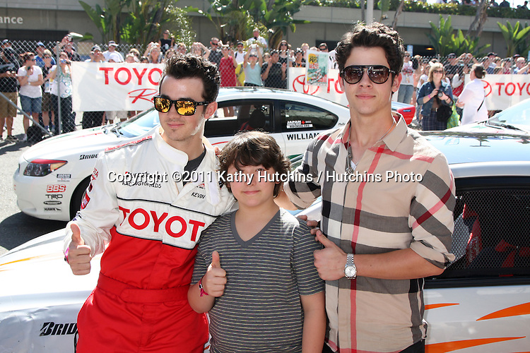 LOS ANGELES - APR 16:  Kevin Jonas , Frankie Jonas, Nick Jonas  at the Toyota Grand Prix Pro Celeb Race  at Toyota Grand Prix Track on April 16, 2011 in Long Beach, CA.