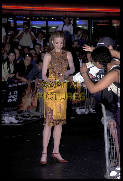 NICOLE KIDMAN.03 September 1999.Ref: 8801.gold dress, fans, autographs, full length, full-length.*RAW SCAN- photo will be adjusted for publication*.www.capitalpictures.com.sales@capitalpictures.com.©Capital Pictures