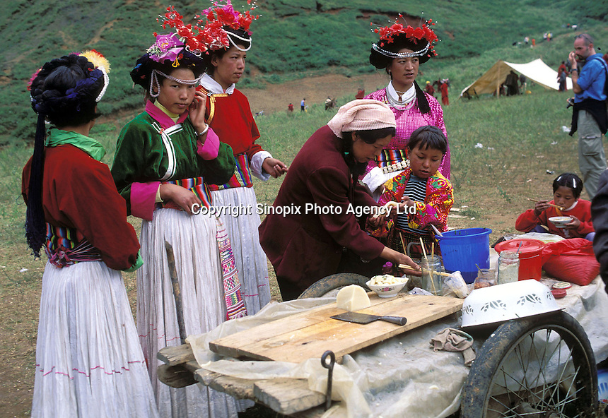 "Mosuo women at the fertility festival dedicated to the god Ganmo. Despite greater exposure to outside influence, the Mosuo women are confident their traditions will endure. Women from the Mosuo tribe do not marry, take as many lovers as they wish and have no word for ""father"" or ""husband"". But the arrival of tourism and the sex industry is changing their culture...PHOTO BY SINOPIX"