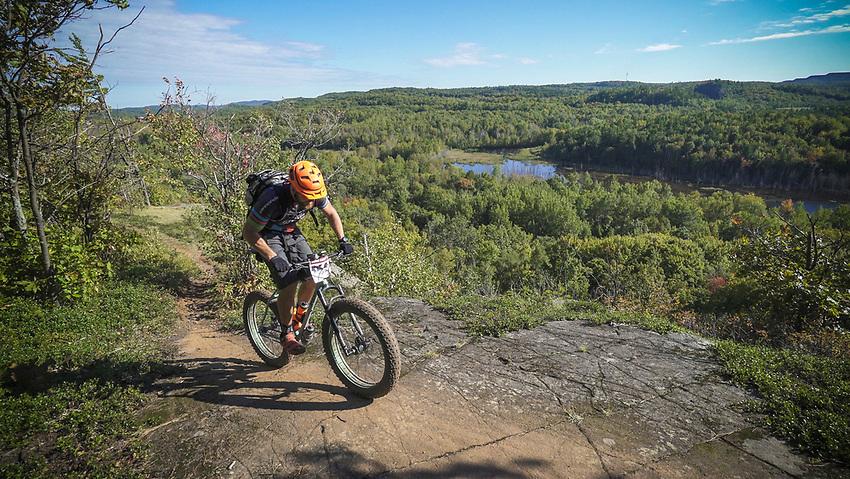 A mountain biker in the Marji Gesick 100 reaches the Panorama Overlook on the RAMBA trail system in Ishpeming, Michigan.
