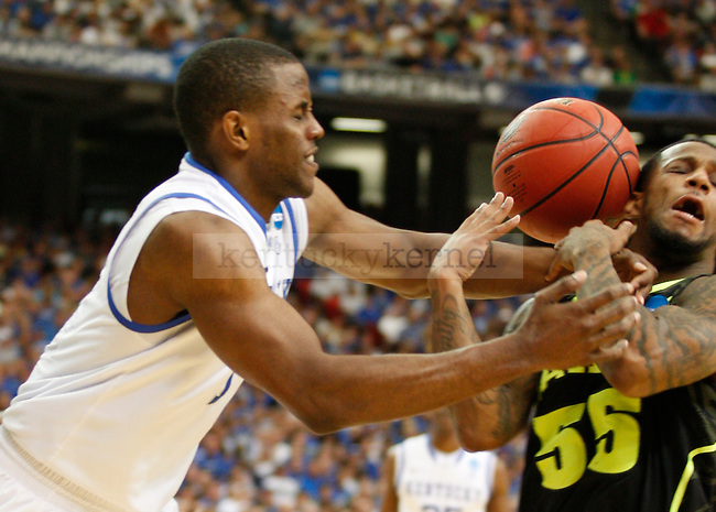 Darius Miller and Pierre Jackson struggle for the ball in the second half of the south region final between the University of Kentucky and Baylor University in the NCAA Tournament, in the Georgia Dome, on Sunday, March 25, 2012 in Atlanta, Ga. Kentucky defeated Baylor 82-70.  Photo by Latara Appleby | Staff. ..