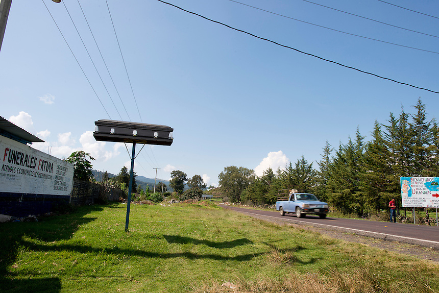 Coffin on a pole, roadside shooting en route to Erongaricuaro, Michoacan, Mexico