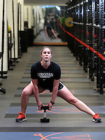 Assistant UVa strength and conditioning coach   Jenny Shultis demonstrates the side lunge exercise at the McCue Center weight room on campus at the University of Virginia in Charlottesville, VA. Photo/Andrew Shurtleff