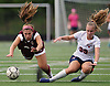 Megan Sullivan #39 of South Side, right, and Gabriella Scott #21 of North Shore get their feet tangled after Sullivan kicked a ball downfield during a Nassau County AB1 varsity girls soccer game at North Shore High School on Friday, Sept. 14, 2018. Neither was injured and play continued without a stoppage. South Side went on to win 2-0.