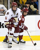 Mike Brennan (Boston College - Smithtown, NY) keeps the puck from Kevin Du (Harvard University - Spruce Grove, AB). The Boston College Eagles defeated the Harvard University Crimson 3-1 in the first round of the 2007 Beanpot Tournament on Monday, February 5, 2007, at the TD Banknorth Garden in Boston, Massachusetts.  The first Beanpot Tournament was played in December 1952 with the scheduling moved to the first two Mondays of February in its sixth year.  The tournament is played between Boston College, Boston University, Harvard University and Northeastern University with the first round matchups alternating each year.