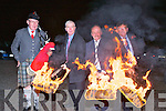 Maurice Costello, Domo O'Ciardubhain and Mike Flynn light up the turf for the march through the village on Thursday night