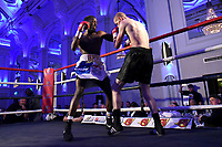 Gelassius Taaru (L) defeats Neil Rawlinson during a Boxing Show at The Devere Grand Connaught Rooms on 9th May 2019