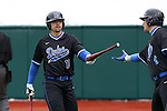 21 February 2015: Duke's Cris Perez (18) hands a bat to Duke's Jack Labosky (right). The Duke University Blue Devils hosted the University of Hartford Hawks in an NCAA Division I Men's baseball game at Jack Coombs Field in Durham, North Carolina. Duke won the game 5-1.