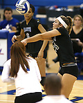 Marymount's Emileigh Rettig passes in a college volleyball game, in Arlington, Vir., on Saturday, Nov. 1, 2014.<br /> Photo by Cathleen Allison