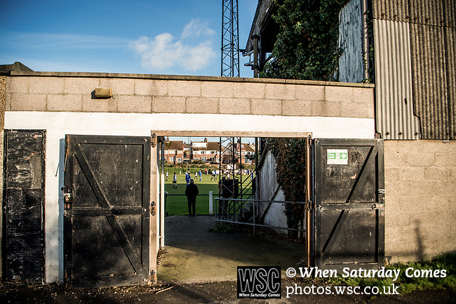Harwich &amp; Parkeston 2 Barnston 0, 11/11/2017. Royal Oak Ground, Andreas Carter Essex &amp; Suffolk Border League Premier Division. Harwich &amp; Parkeston reached the final of the Amateur Cup in 1953 at Wembley Stadium and played in front of a crowd of 100,000. <br /> A glimpse of the action form outside the Royal Oak Ground. Photo by Simon Gill.
