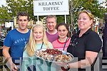 Eileen McClure offers some Killarney toffee to William, Orla and Caragh Browne with Dave Anderson at the Flavour of Killorglin on Sunday