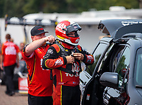 Aug 18, 2018; Brainerd, MN, USA; NHRA top fuel driver Doug Kalitta with crew member during qualifying for the Lucas Oil Nationals at Brainerd International Raceway. Mandatory Credit: Mark J. Rebilas-USA TODAY Sports