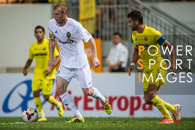 (L) Jeremy Mathieu of Valencia CF followed by (R) Mateo Musacchio of Villarreal CF during LFP World Challenge 2014 between Valencia CF vs Villarreal CF on May 28, 2014 at the Mongkok Stadium in Hong Kong, China. Photo by Victor Fraile / Power Sport Images
