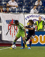 Seattle Sounders FC midfielder Steve Zakuani (11) dribbles at line as New England Revolution defender Kevin Alston (30) defends. The New England Revolution defeated the Seattle Sounders FC, 3-1, at Gillette Stadium on September 4, 2010.