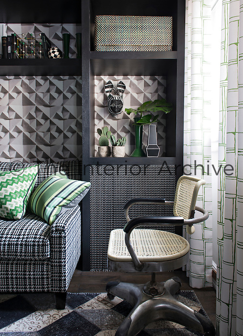 In the bedroom, a bold colour approach of black and shades of grey is offset with the single colour – viridian. Patterned cushions in shades of green are arranged on the comfortable sofa whist other items and cacti are displayed on a built-in shelving unit.