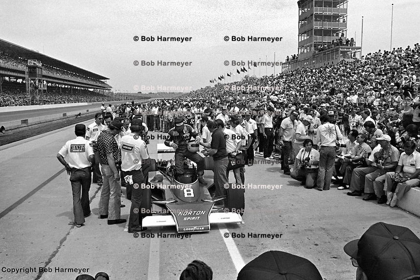 INDIANAPOLIS, IN: Tom Sneva exits his  McLaren M24/Cosworth TC after becoming the first person to officially drive a lap above 200mph during qualifying for the Indianapolis 500 on May 29, 1977, at the Indianapolis Motor Speedway.