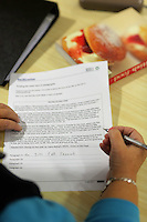 Pictured: An adult is learning how to read and write at the Melin Advice Centre in Neath. Monday 24 October 2016<br /> Re: Communities First funding at the MCC Melin Advice Centre in Neath, Wales, UK.