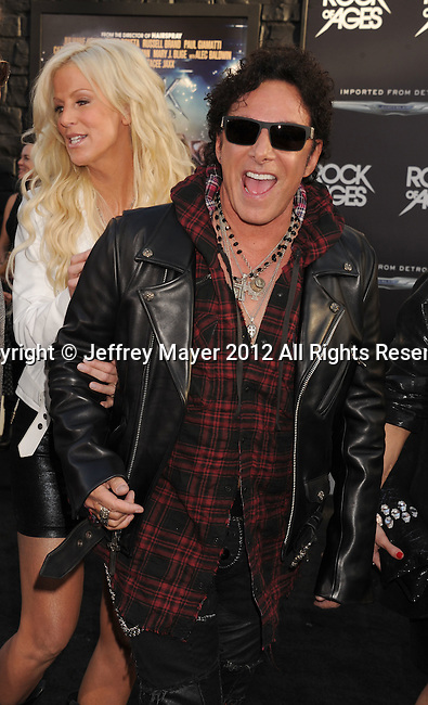 HOLLYWOOD, CA - JUNE 08: Neal Schon of Journey arrive at the 'Rock Of Ages' - Los Angeles Premiere at Grauman's Chinese Theatre on June 8, 2012 in Hollywood, California.