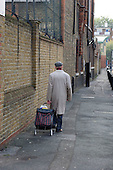 An elderly man with a shopping trolley in Southwark, South London.