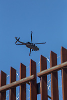 MEXICALI, MEXICO - April 5 A Helicopter from the Customs and Border Protection Office flies over the US-Mexico Border wall on April 5, 2019 in Mexicali, Mexico.<br /> President Trump on Friday visited Calexico, a small city in a largely agricultural region between Arizona and the Pacific, to inspect an upgraded portion of fencing and to meet with law enforcement. That's more attention than usual for a border town that locals say is defined by its interconnection with Mexico, its infernal summers and its labor-based economy. <br /> (Photo by Luis Boza/VIEWpress)