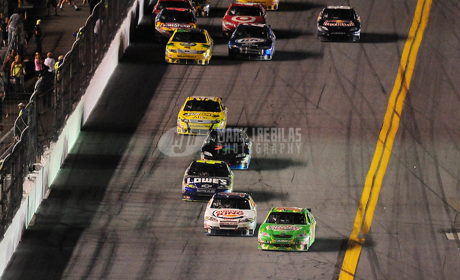 Jul. 4, 2009; Daytona Beach, FL, USA; NASCAR Sprint Cup Series driver Kyle Busch (18) leads Tony Stewart (14) on the last lap during the Coke Zero 400 at Daytona International Speedway. Mandatory Credit: Mark J. Rebilas-