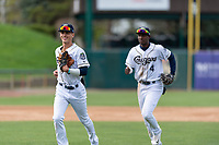 Kane County Cougars Blaze Alexander (5) and Geraldo Perdomo (4) jog off the field between innings of a Midwest League game against the Cedar Rapids Kernels at Northwestern Medicine Field on April 28, 2019 in Geneva, Illinois. Kane County defeated Cedar Rapids 3-2 in game one of a doubleheader. (Zachary Lucy/Four Seam Images)