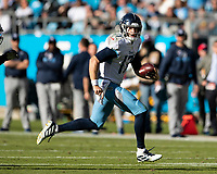 CHARLOTTE, NC - NOVEMBER 3: Ryan Tannehill #17 of the Tennessee Titans runs with the ball during a game between Tennessee Titans and Carolina Panthers at Bank of America Stadium on November 3, 2019 in Charlotte, North Carolina.
