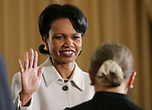 Secretary of State Condoleezza Rice takes the Oath of Office from Supreme Court Justice Ruth Bader Ginsberg(C) during a swearing in ceremony in the Benjamin Franklin Room of the Department of State in Washington, DC Friday 28 January 2005. Secretary Rice, who is the second woman and the first black woman to become Secretary of State, was sworn in by White House chief of staff Andrew Card Wednesday evening, hours after the Senate confirmed her by a vote of 85 to 13,  in a private ceremony at the White House.<br /> Credit: Shawn Thew / Pool via CNP