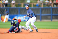 Tampa Bay Rays shortstop Hak-Ju Lee #36 attempts to turn a double play as Tony Thomas #97 slides in during a Grapefruit League Spring Training game against the Boston Red Sox at Charlotte County Sports Park on February 25, 2013 in Port Charlotte, Florida.  Tampa Bay defeated Boston 6-3.  (Mike Janes/Four Seam Images)