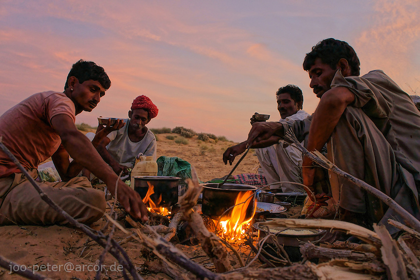 camp fire of camel guides in the desert dunes about 40km west of Jaisalmer,Rajastan, India