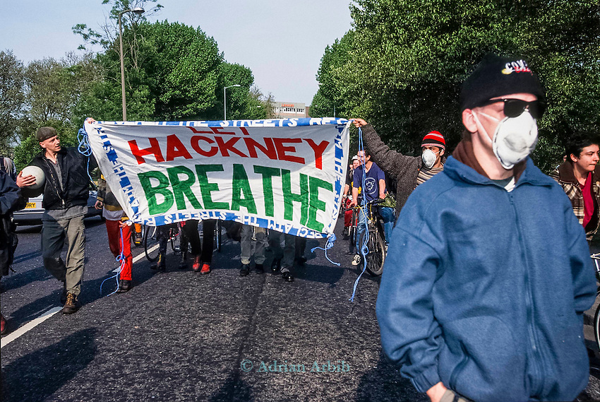 Reclaim the Streets (RTS) protest in Hackney - Stop the traffic .  `RTS  was born of the road protests at Twyford Down and the M11 , a response to the prevailing  car culture and associated pollution and  alienation.