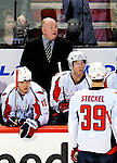 10 February 2010: Washington Capitals' Head Coach Bruce Boudreau looks out from behind the bench during a game against the Montreal Canadiens at the Bell Centre in Montreal, Quebec, Canada. The Canadiens defeated the Capitals 6-5 in sudden death overtime, ending Washington's team-record winning streak at 14 games. Mandatory Credit: Ed Wolfstein Photo