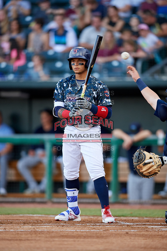 Jacksonville Jumbo Shrimp second baseman Isan Diaz (11) at bat during a game against the Mobile BayBears on April 14, 2018 at Baseball Grounds of Jacksonville in Jacksonville, Florida.  Mobile defeated Jacksonville 13-3.  (Mike Janes/Four Seam Images)