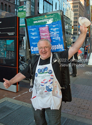 Marc Daniels of Springfield, Illinois, who sells Jewish Campaign Kippahs (yarmulkes), shows off his merchandise on Euclid Avenue near the Quicken Loans Arena, site of the 2016 Republican National Convention in Cleveland, Ohio on Saturday, July 16, 2016.<br /> Credit: Ron Sachs / CNP<br /> (RESTRICTION: NO New York or New Jersey Newspapers or newspapers within a 75 mile radius of New York City)