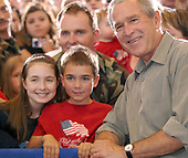 Martinsburg, WVa - July 4, 2007 -- United States President George W. Bush poses with guest for photos after speaking to the West Virginia Air National Guard 167th Airlift Wing and other guests on base in Martinsburg, West Virginia, on July 4, 2007.  <br /> Credit: Roger L. Wollenberg - Pool via CNP