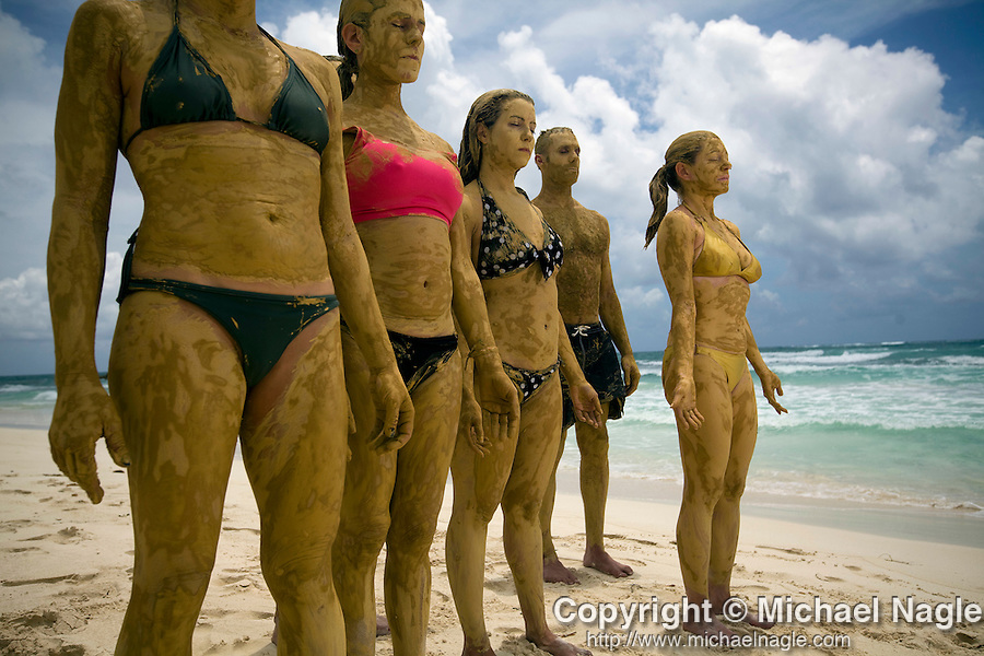 TULUM, MEXICO - APRIL 30, 2009: A group from New York on a yoga retreat meditate while covered in golden-colored mud during a Mayan Clay treatment at Casa de Miel on April 30, 2009 in Tulum, Mexico.  (PHOTOGRAPH BY MICHAEL NAGLE)