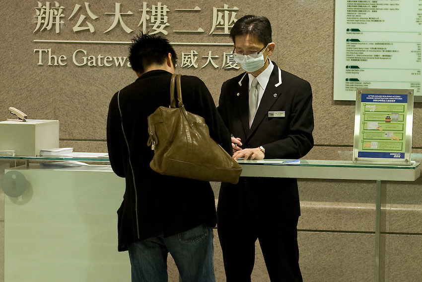 In Hong-kong, firt swine flu cases have incited employees in contact with customers to use masks. Here in the Ocean center,in the lobby of the Gateway Tower. May 21 2009