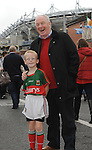 Minister of State Michael Ring TD with his grandson Rory McGreal on their way to the All Ireland final replay.<br /> Pic Conor McKeown