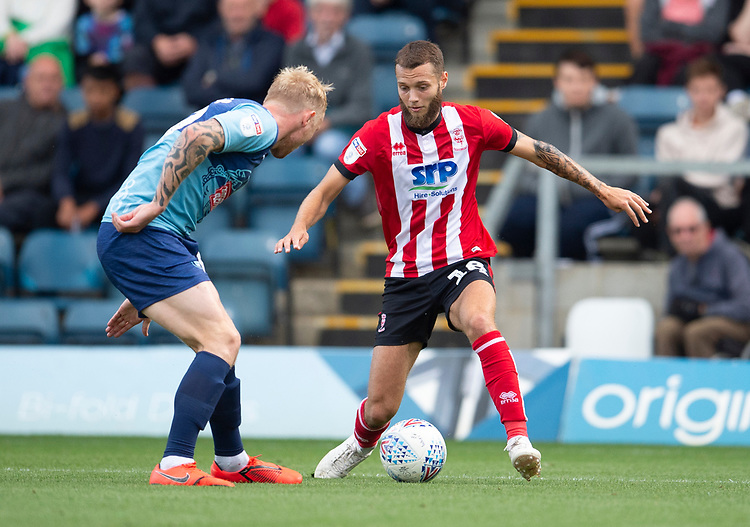 Lincoln City's Jorge Grant vies for possession with Wycombe Wanderers' Jack Grimmer<br /> <br /> Photographer Andrew Vaughan/CameraSport<br /> <br /> The EFL Sky Bet League One - Wycombe Wanderers v Lincoln City - Saturday 7th September 2019 - Adams Park - Wycombe<br /> <br /> World Copyright © 2019 CameraSport. All rights reserved. 43 Linden Ave. Countesthorpe. Leicester. England. LE8 5PG - Tel: +44 (0) 116 277 4147 - admin@camerasport.com - www.camerasport.com