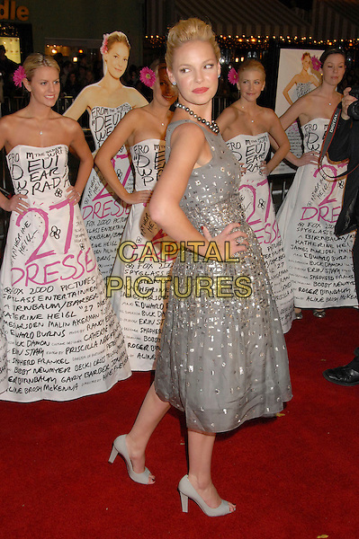"KATHERINE HEIGL.At the ""27 Dresses"" Los Angeles Premiere held at the Mann Village Theatre, Westwood, California,.USA, 07 January 2008..full length back over shoulder grey gray beads necklace dress shoes hands on hips rear silver beaded .CAP/ADM/BP.©Byron Purvis/AdMedia/Capital Pictures."