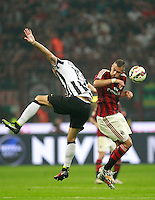 Calcio, Serie A: Milan vs Juventus, Milano, stadio San Siro, 20 settembre 2014.<br /> Juventus defender Leonardo Bonucci, left, and AC Milan forward Jeremy Menez, of France, jump for the ball during the Italian Serie A football match between AC Milan and Juventus at Milan's San Siro stadium, 20 September 2014.<br /> UPDATE IMAGES PRESS/Isabella Bonotto