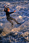 Reed Weseman boogie boards in surf at beach along West Cliff Drive, Santa Cruz, CALIFORNIA