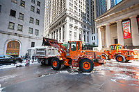 New York Department of Sanitation workers use heave equipment  to remove snow from Wall Street in front of Federal Hall and the New York Stock Exchange after Winter Storm Stella on Thursday, March 16, 2017. (© Richard B. Levine)