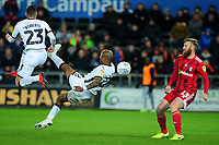 Andre Ayew of Swansea City attempts a overhead kick during the Sky Bet Championship match between Swansea City and Fulham at the Liberty Stadium in Swansea, Wales, UK. Friday 29 November 2019